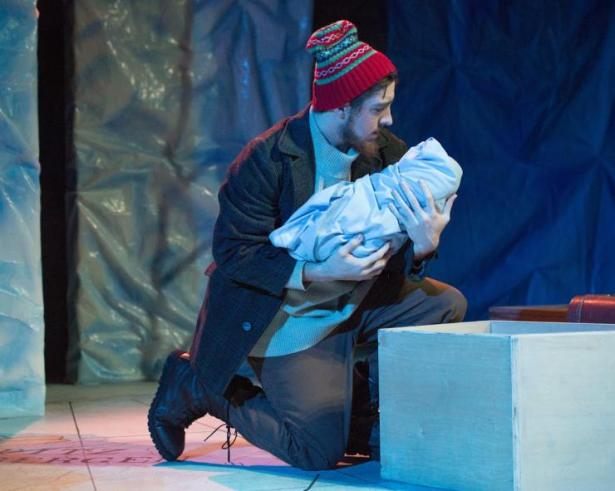 Sterling Oliver as a father saying his goodbyes to his child before leaving to work on an oil rig. Forward, Kansas State University Theatre, 2016.